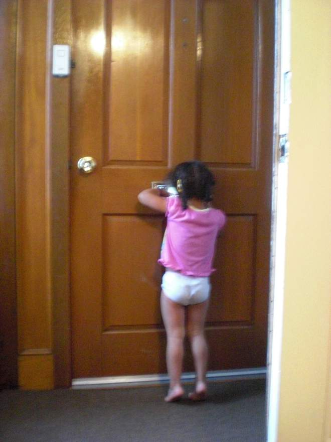 "Hope, age 2, ""looking for Daddy"" through the mailslot when he was deployed in 2009-2010."